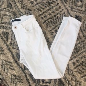 Mid-rise white skinny jeans